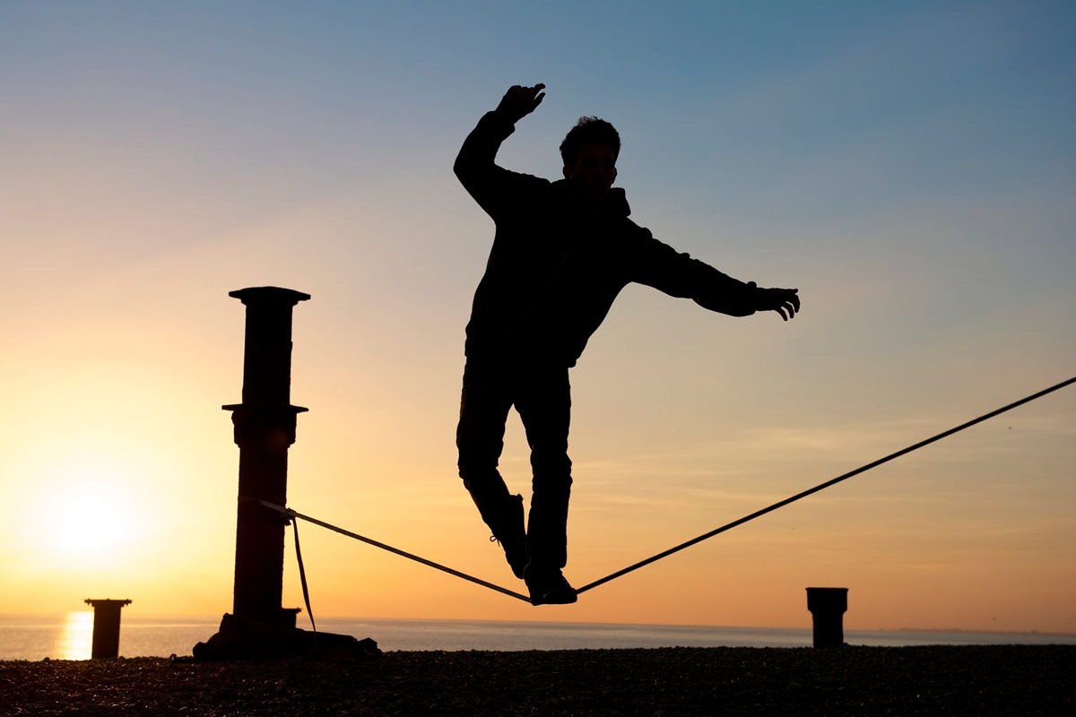 Guy Balancing on Tightrope